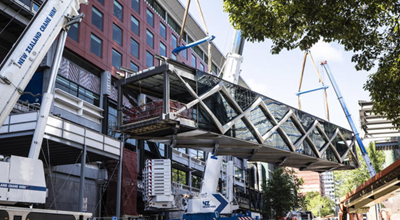 Watch the SkyCity pedestrian bridge being lifted into place